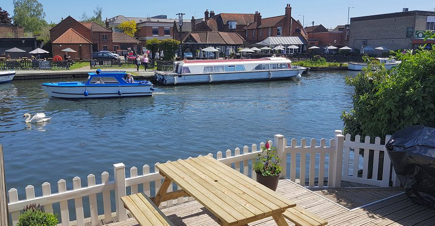 River scene from Wroxham Cottage terraces with constantly changing views of boats and wildlife