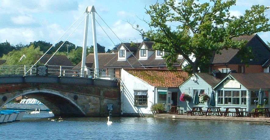 'Bridge Restauraunt' and Wroxham Bridge next to cottages - there are many places to eat within a few minutes walk