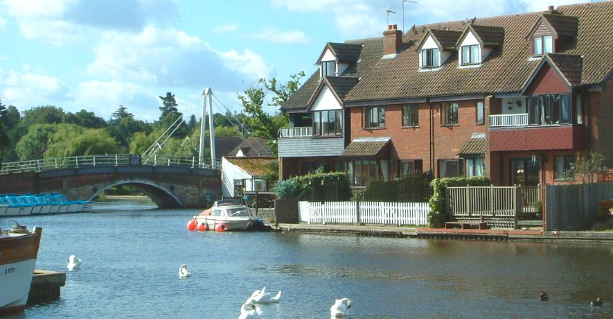 Looking towards Wroxham Cottages from across the river from the moorings opposite