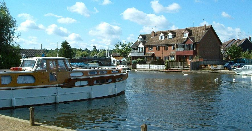 Anchor & Riverside Cottages (white fences) situated close to the centre of Wroxham, 'Capital of the Norfolk Broads'