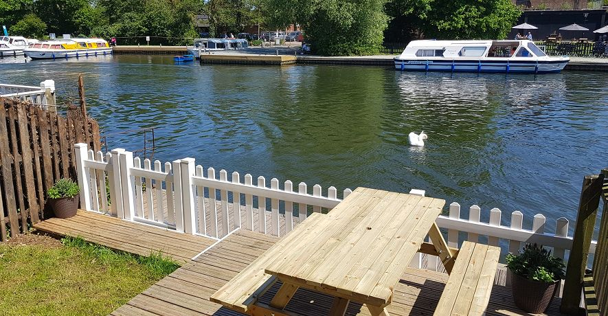 Riverside Cottage waterside decking - perfect for relaxing, fishing or watching the boats